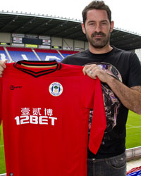 Scott Carson poses with Wigan jersey